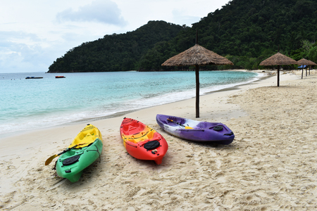 Colourful of kayaks stand on a sandy beach in Vacation. Background Stok Fotoğraf