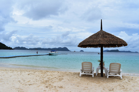 Chairs and Umbrella in Tropical Beach on Vacation. Image