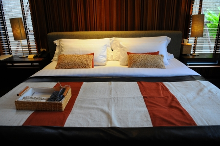 Hotel room in a tropical resort with a comfortable bed photo