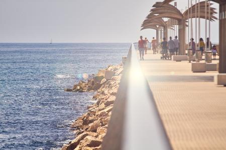 ALICANTE, SPAIN, CIRCA JUNE 2018 People walking on a pier.