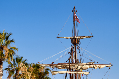Mast of the spanish replica of the Nao de Santa Maria with some palm trees