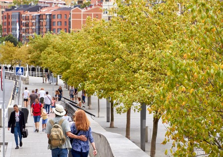 BILBAO, SPAIN, CIRCA AUGUST 2018, people walking next to the river