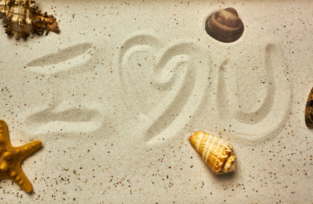 I love you message in the sand