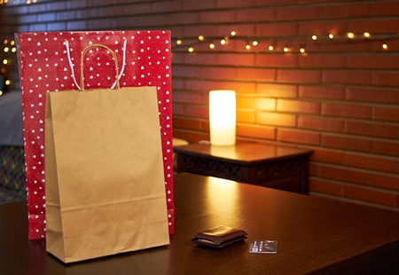Shopping paper bags on a table Imagens