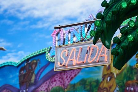 spanish exit neon sign in funfair Imagens
