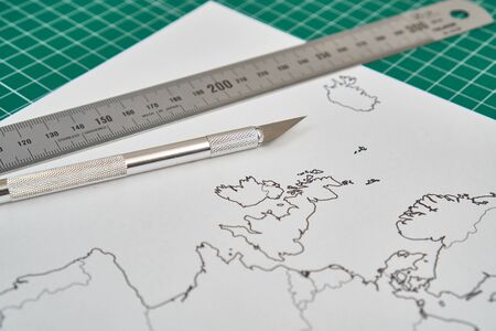 europe map with a ruler and a cutter