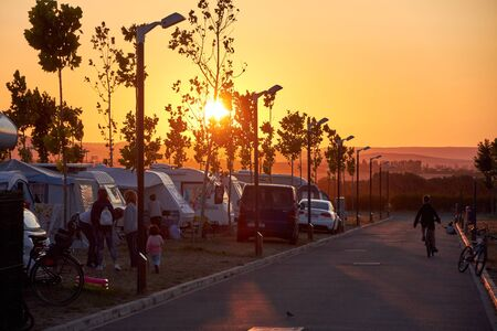 SPAIN CIRCA AUGUST 2018 vans tent campsite on the sunset with some trees