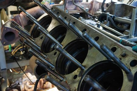 Engine cylinders diesel generator set without sleeves. Disassembled diesel generator.
