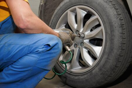 The process of changing tires on a car before the season. The process of removing the wheel from the car. Replacing a set of rubber before the season.