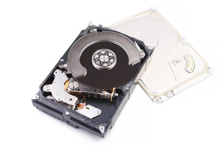 Repair and maintenance of Hdd - hard disk drive. Hard disk repair concept, computer industry. Disassembled hard drive from the computer 3.5' SATA on white background.