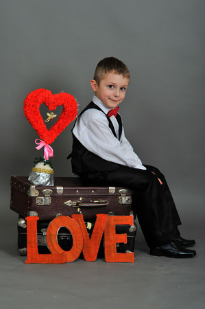 5 6 years: boy in the suitcase with the words love and hearts