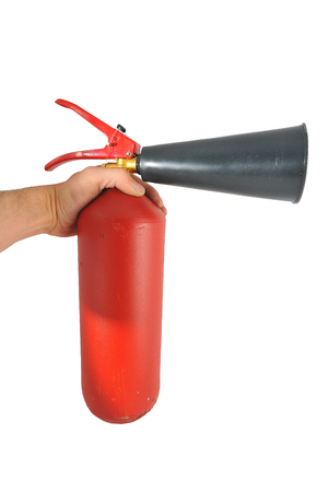 hand red: in hand red metal fire extinguisher and a plastic spray