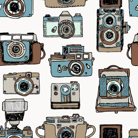 Vector seamless pattern with old fashioned cameras. Hand drawn set of vintage photo camera. Stock Vector - 90539720