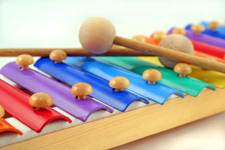 colourful childs glockenspiel with two crossed mallets photo
