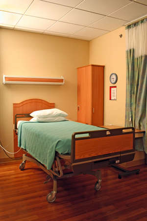 hospital bed: clean empty bed in a hospital