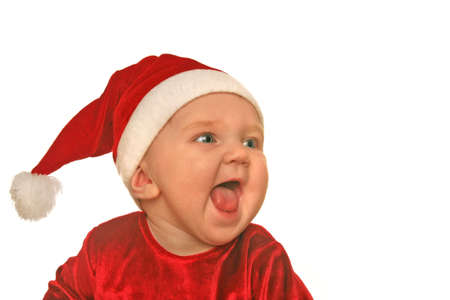 joyfully: cute baby in christmas hat and clothing shrieking joyfully