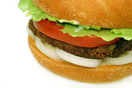 homestyle: homestyle beef burger with onion rings, tomato and lettuce close up Stock Photo