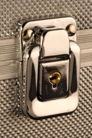 close - up of a metal lock from a safe box protecting a treasure