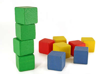 organic concept: green block tower standing and other colors scattered. Environmental  organic concept Stock Photo