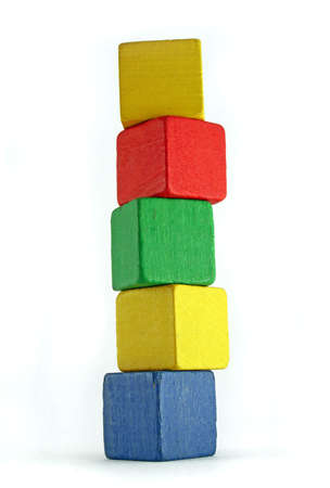 yellow block: colorful wooden cilds blocks stacked into a very high tower