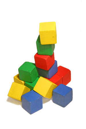 a tower of colorful wooden childrens blocks