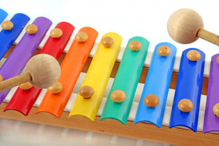 struck: colourful childs glockenspiel with two wooden mallets, playing