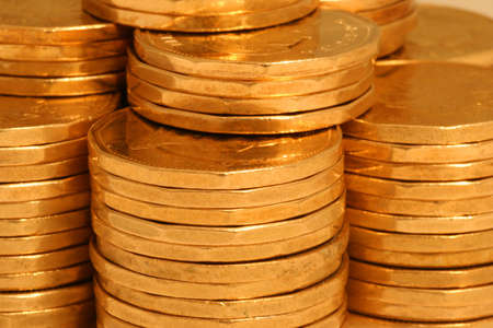 golden coins in stacks, close up view from side
