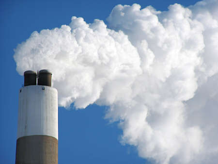 smoke stack: close up of the top a coal plant smoke stack emitting a load of exhaust smoke and contributing to the global warming