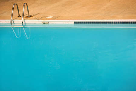 plain simple background of an empty blue swimming pool with plenty of copyspace