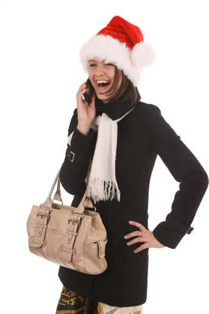 christmas girl in a santa hat laughing on the cell phone, isolated on white background Stock Photo