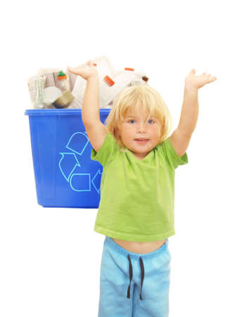 environmentalism: happy kindergarten girl cheering beside a recycle bin after finishing her eco project