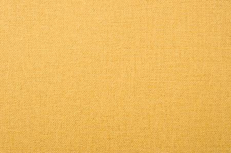 canvas texture wallpaper. golden textured background. Stock Photo