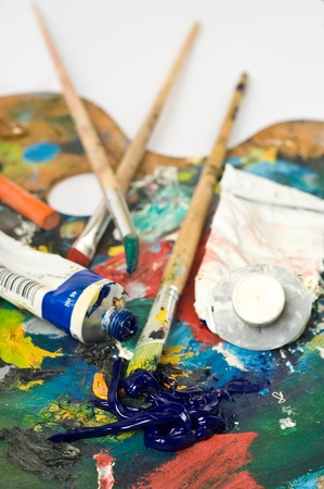 artist's palette with colorful paint and brushes. Stock Photo - 11255392