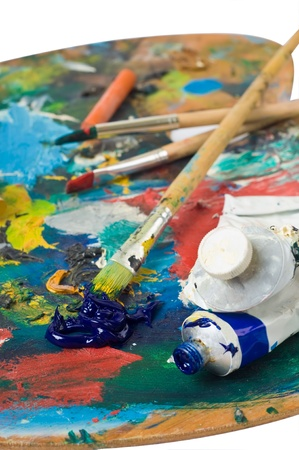 artists palette with colorful paint and brushes. Stock Photo