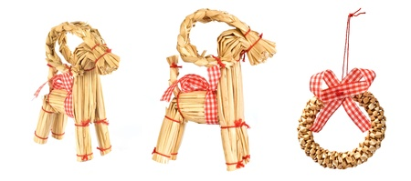 christmas decorations from straw. wreath and goat. each one is shot separately.