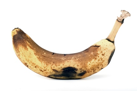 rotten banana isolated over white  unhealthy food Stock Photo