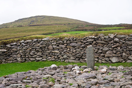 co kerry: An old cross carved in the stone near Gallarus oratory in Ireland Co. Kerry. Early Christian.