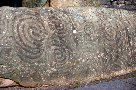 Entrance stone in Newgrange, very old historical site in Ireland