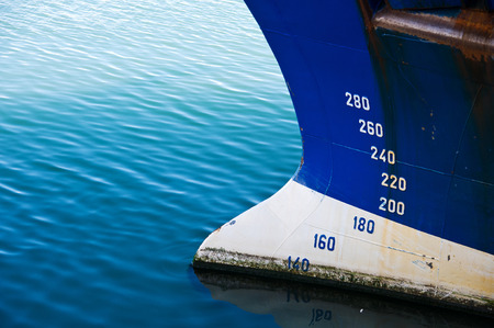 The detail of a ship in a water. Marine theme.
