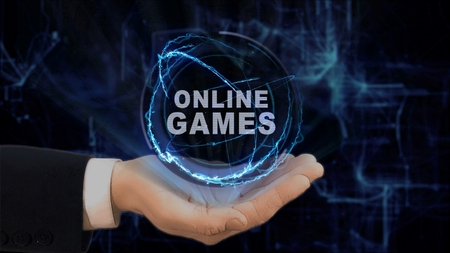 Painted hand shows concept hologram Online Games on his hand. Drawn man in business suit with future technology screen and modern cosmic background