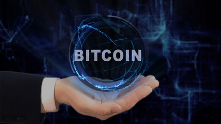 Painted hand shows concept hologram Bitcoin on his hand. Drawn man in business suit with future technology screen and modern cosmic background Фото со стока