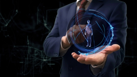 Businessman shows concept hologram 3d woman on his hand. Man in business suit with future technology screen and modern cosmic background