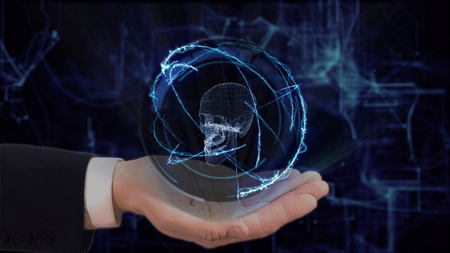 Painted hand shows concept hologram 3d skull on his hand. Drawn man in business suit with future technology screen and modern cosmic background