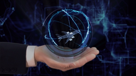 Painted hand shows concept hologram 3d plane on his hand. Drawn man in business suit with future technology screen and modern cosmic background