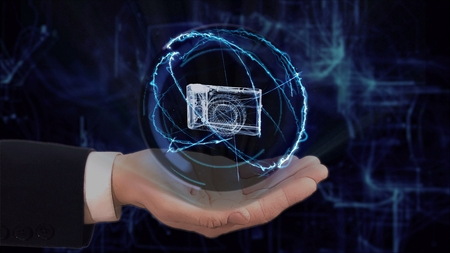 Painted hand shows concept hologram 3d pocket camera on his hand. Drawn man in business suit with future technology screen and modern cosmic background