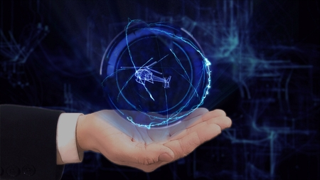 Painted hand shows concept hologram 3d helicopter on his hand. Drawn man in business suit with future technology screen and modern cosmic background