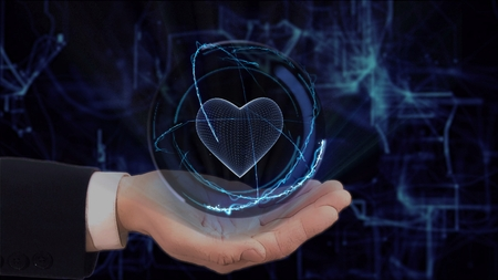 Painted hand shows concept hologram heart on his hand. Drawn man in business suit with future technology screen and modern cosmic background