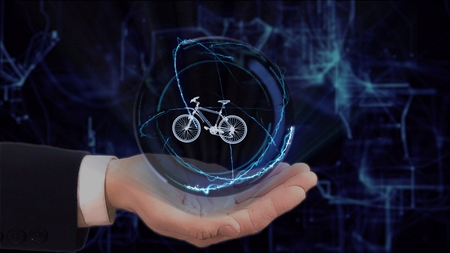 Painted hand shows concept hologram 3d cycle on his hand. Drawn man in business suit with future technology screen and modern cosmic background Stockfoto