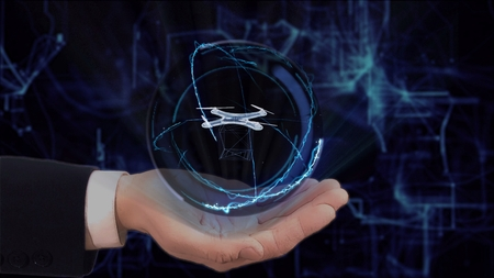 Painted hand shows concept hologram 3d Drone on his hand. Drawn man in business suit with future technology screen and modern cosmic background