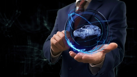 Businessman shows concept hologram 3d family car on his hand. Man in business suit with future technology screen and modern cosmic background Stockfoto
